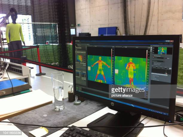 Monitors show thermal images of a running athlete at the test centre of sports equipment manufacturer Adidas in Herzogenaurach Germany 18 June 2013...