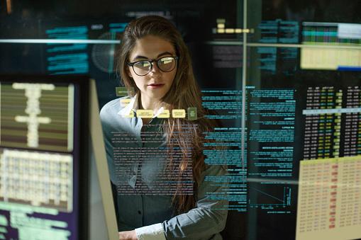 Monitors woman see thru data 1175547284