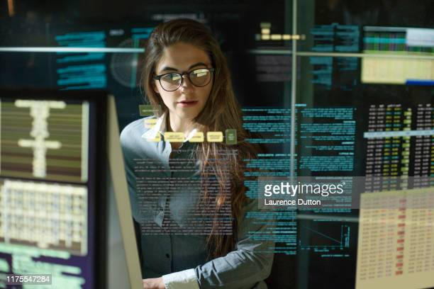 monitors woman see thru data - science stock pictures, royalty-free photos & images
