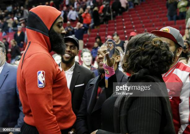 Monja Willis greets her son James Harden of the Houston Rockets after the game with an official James Harden Cheer Puppet after the game against the...