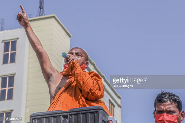 Monk addresses the crowd of protesters during the military coup protest in Mandalay. A massive crowd took to the streets of Mandalay to protest...