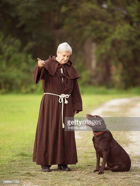 monk and his dog - ceremonial robe stock pictures, royalty-free photos & images