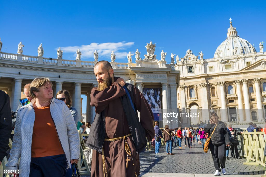 Monk and tourists at St. Peter's square : Stock Photo