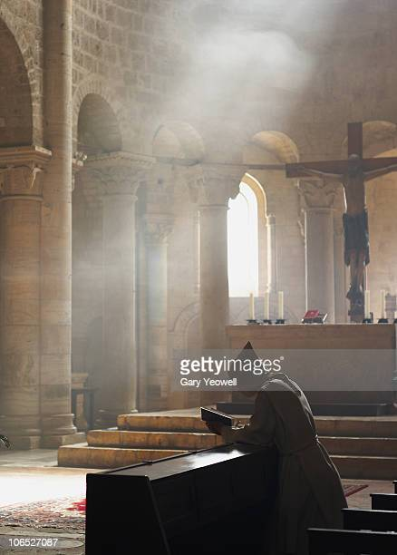 Monk at prayer in Abbey of San't Antimo