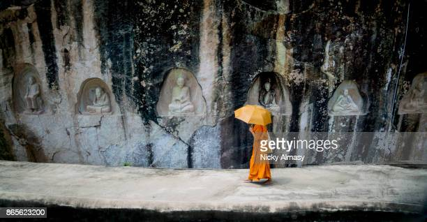 monk at wat tamphaden temple - buddhism stock pictures, royalty-free photos & images