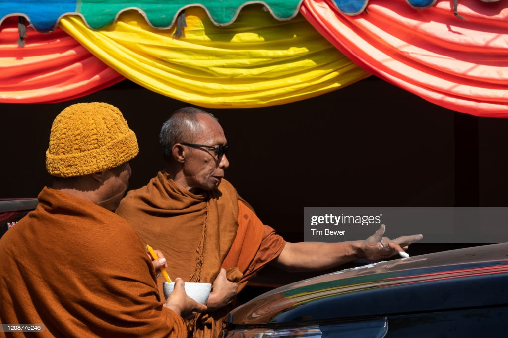 Monk blessing a truck. : Stock Photo