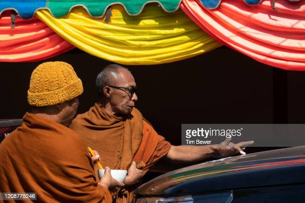 monk blessing a truck. - tim bewer stock pictures, royalty-free photos & images