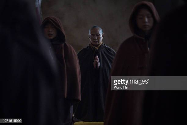 A monk chants scriptures in the Tiantai Temple on November 21 2018 in Hongan Hubei province ChinaMonks of Tiantai Temple are proficient not only in...