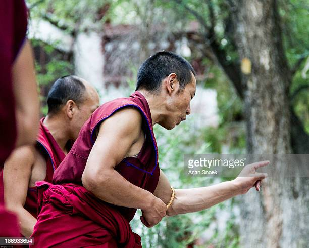 CONTENT] Monk debating fellow monks in Lhasa monestary