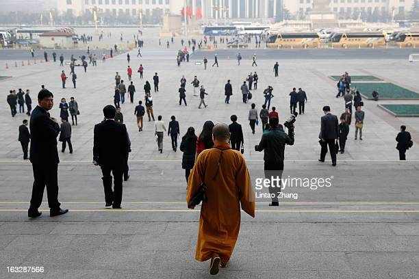 Monk delegate walks out the Great Hall of the People after a plenary session of the Chinese People's Political Consultative Conference on March 7,...