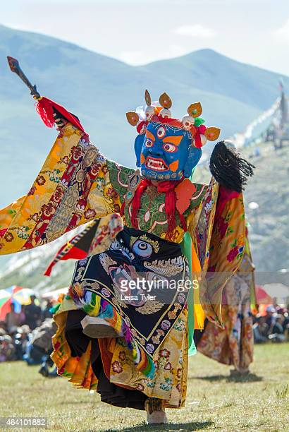A monk dressed as a deity performs a temple dance at the Yushu Horse Racing Festival in Qinghai The masks worn during the dances are supposed to...