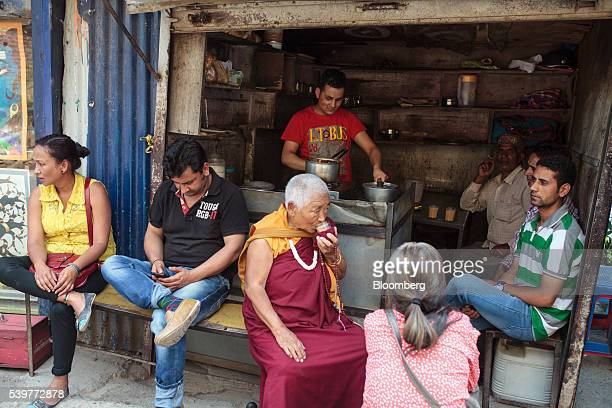 A monk drinks chai at a tea stall in the McLeod Ganj area of Dharamsala India on Saturday June 4 2016 Consumer Price Index figures for May are...