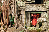 Monk exploring old ruins