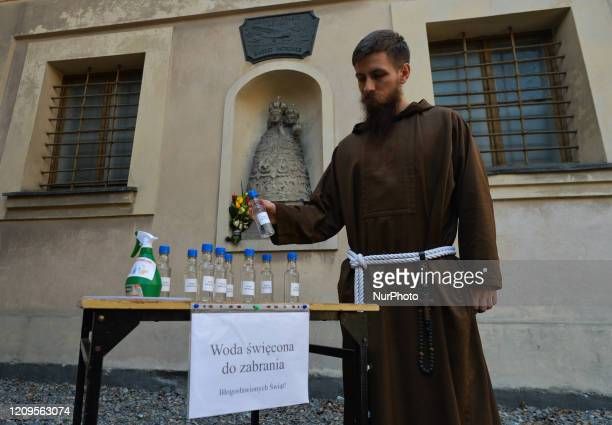 A monk from the Order of Friars Minor Capuchins in Krakow holds a bottle with the Holy Water This year's Easter holy week especially Good Friday will...