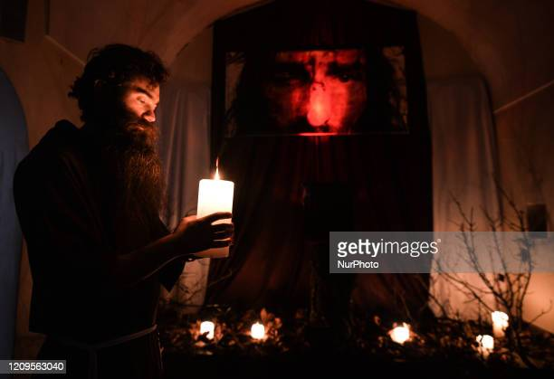 A monk from the Order of Friars Minor Capuchins prepares the tomb of Christ inside the Cloister Church in Krakow On Thursday April 9 in Krakow Poland