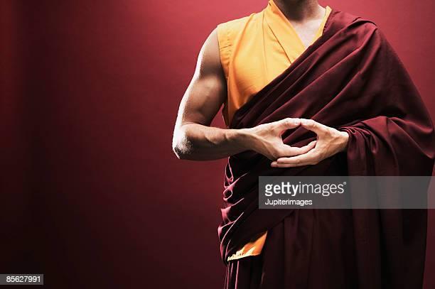 Monk giving hand gesture