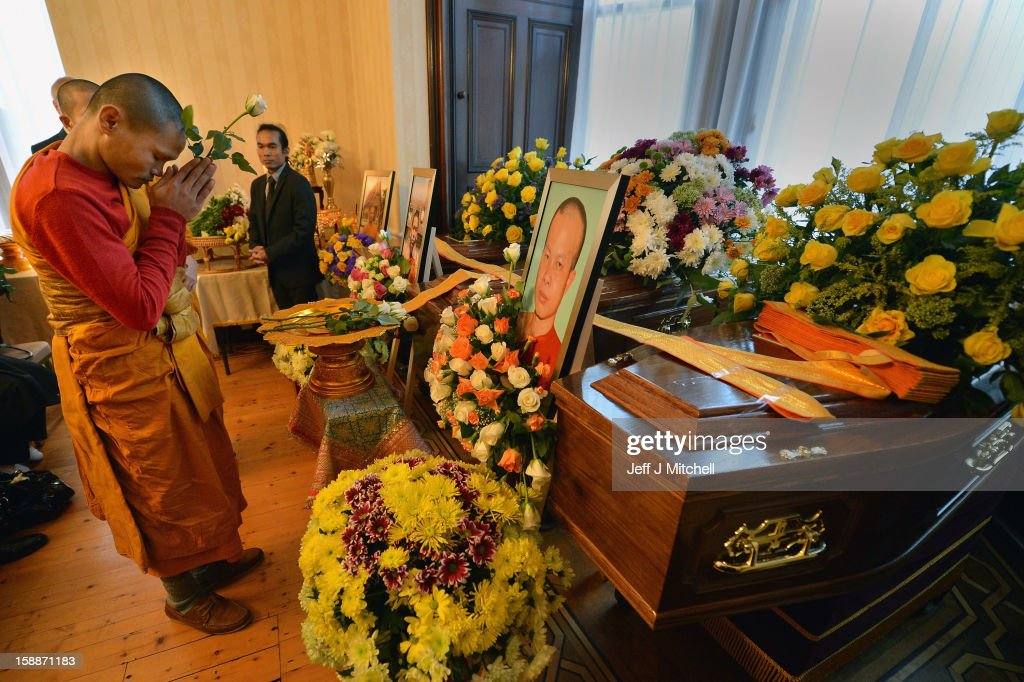 A monk holds a flower and prays at a service of remembrance for three thai Buddhist Monks who died in a car crash on Christmas Eve, at Oakvale Funeral Home on January 2, 2013 in Edinburgh, Scotland. Abbot Phramaha Pranom Thongphaiboon, 43, head of the Thai Buddhist community in Aberdeen, was killed in a car crash on Christmas Eve along with his colleagues Phramaha Kriangkrai Khamsamrong, 35, and Phramaha Chai Boonma, 36. The three men were travelling to the Dhammapadipa Temple in Edinburgh when they were involved in the head-on collision on the A68 near Pathhead, Midlothian.