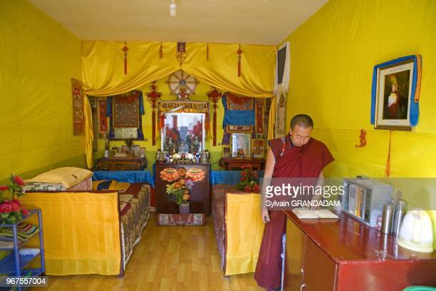 Monk in his room decorated by himself Pu sa ding lama temple and monastery Wutai shan one of the most ancient and renowned buddhist pilgrimage sites...