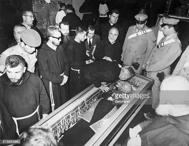 A monk kisses the glass overed coffin of Padre Pio of Pietralcina in the Church of St Mary of the Graces here The Capuchin monk considered a Saint by...