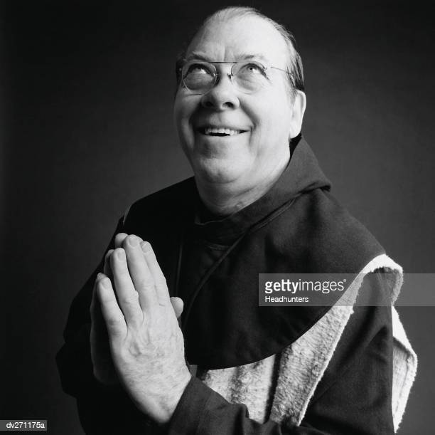 monk looking up, praying - headhunters stock pictures, royalty-free photos & images