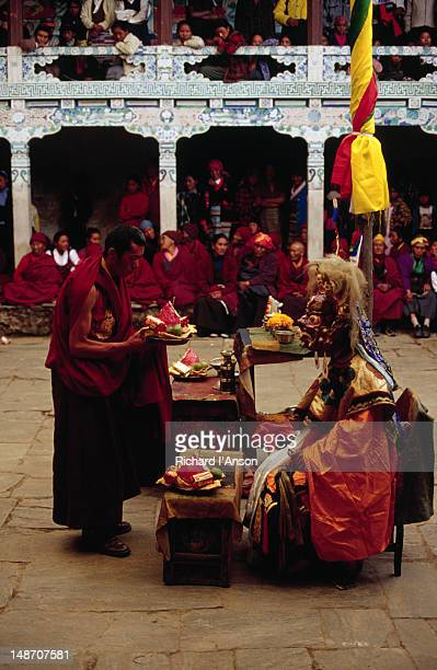 monk making an offering during a ritualistic dance at the mani rimdu festival at chiwang gompa (monastery). - mani rimdu festival stock pictures, royalty-free photos & images