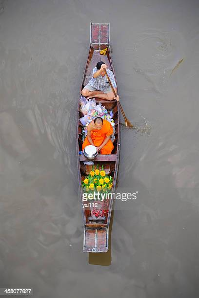 monk on the river - floating market stock pictures, royalty-free photos & images
