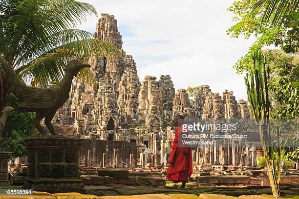 Monk outside ornate Hindu temple