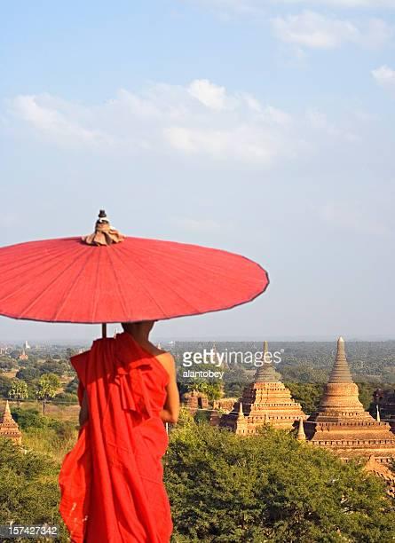 A monk overlooking the Bagan temples of Myanmar