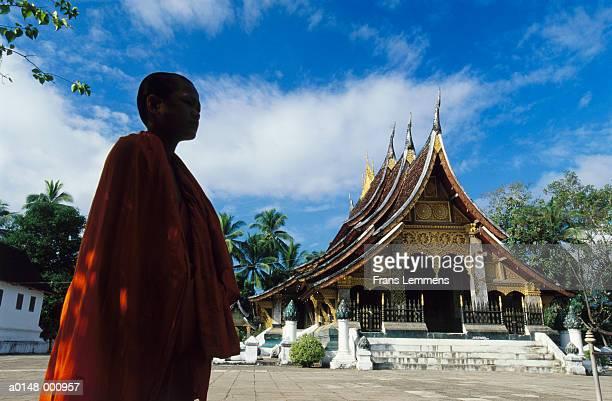 Monk Passing Buddhist Temple