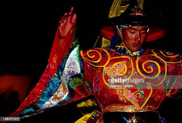 monk performing lama dance at mani rimdu festival. - mani rimdu festival stock pictures, royalty-free photos & images
