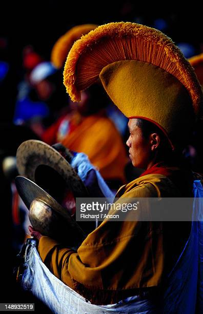 monk playing cymbals at mani rimdu festival. - mani rimdu festival stock pictures, royalty-free photos & images