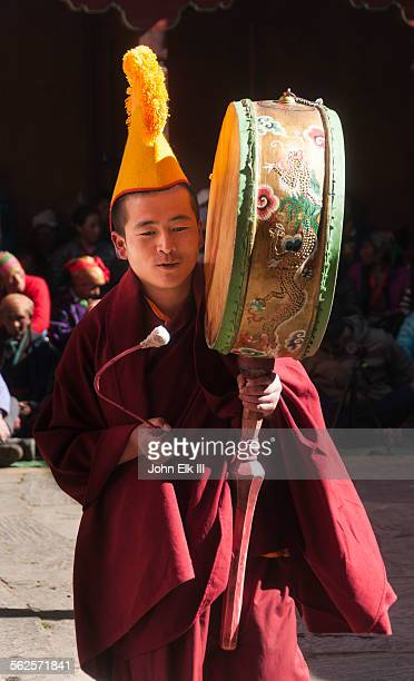 monk playing drum - mani rimdu festival stock pictures, royalty-free photos & images