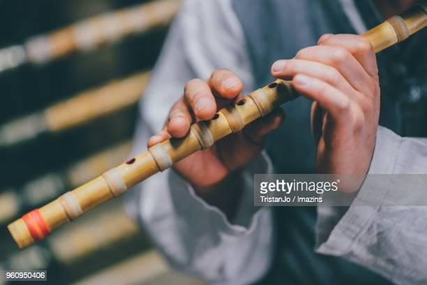 Monk playing Korea Bamboo Flute