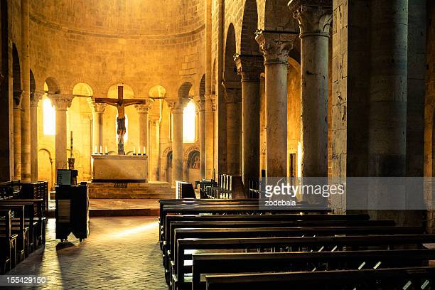 monk praying inside medieval abbey - christianity stock pictures, royalty-free photos & images