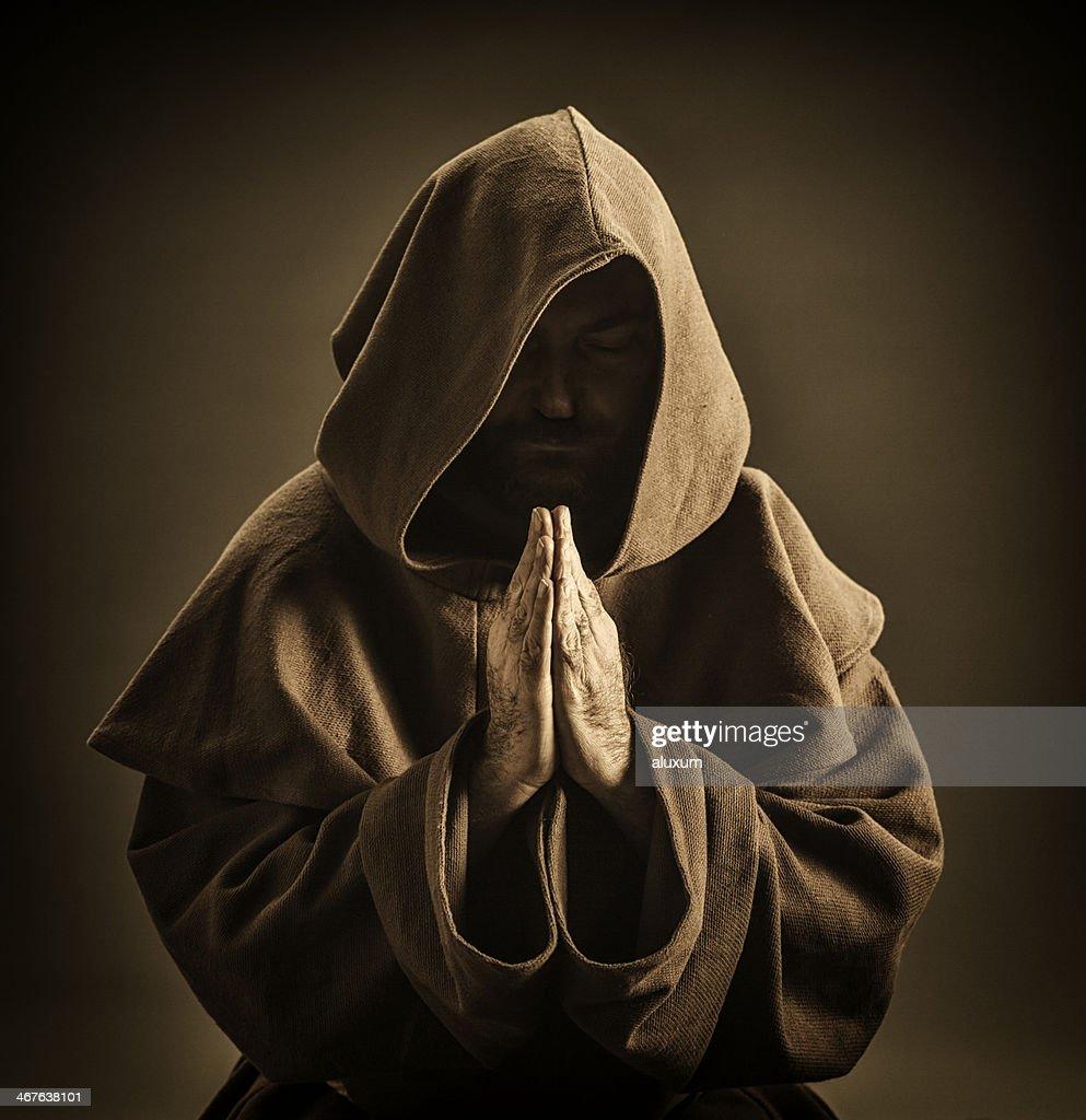 Monk praying : Stock Photo