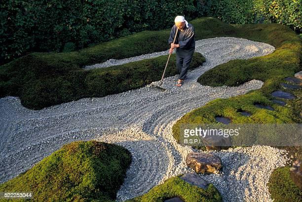 Monk Raking Gravel in Zen Garden