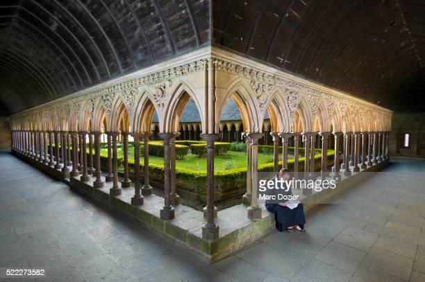 Monk reading in Mont Saint Michel