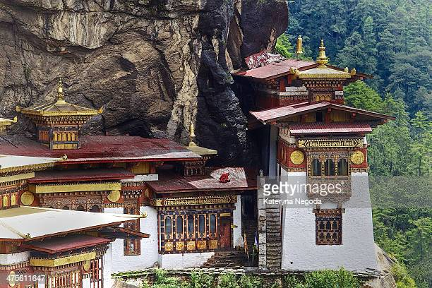 Monk reading mantras on the roof of Tigers Nest. Taktsang Monastery in Paro, Bhutan