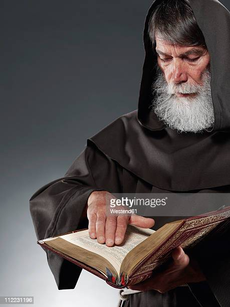 Monk reading the bible