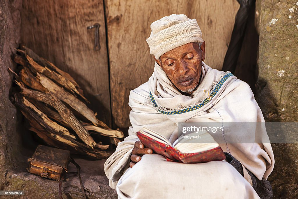 Monk reading the holy book near one of Lalibela's churches : Stock Photo
