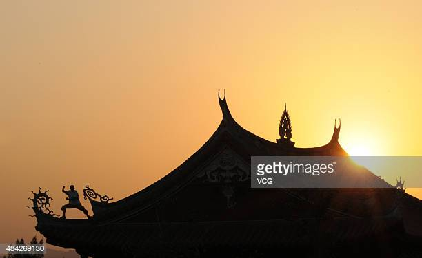 Monk Shi Liliang is playing boxing on the roof on October 23 2009 in Quanzhou Fujian Province of China Shi Liliang the Quanzhou South Shaolin monk...