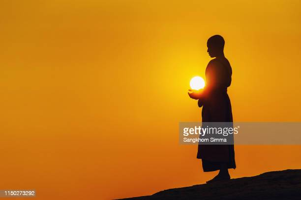 a monk standing meditation. - monk stock pictures, royalty-free photos & images