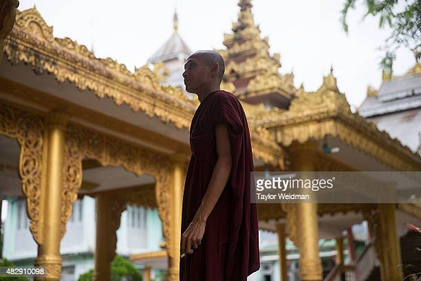 A monk stands in front of a monastery near the planned Dawei SEZ on August 3 2015 in Pantininn Myanmar The controversial multibillion dollar Dawei...