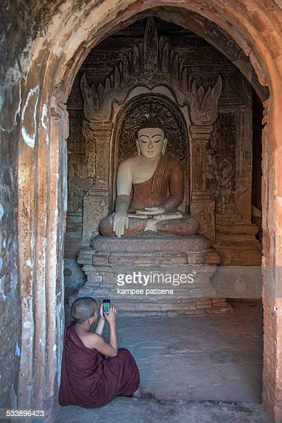 Monk using cell phone