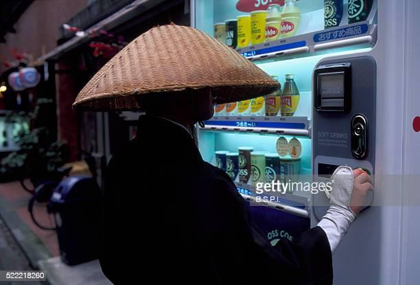 Monk Using Vending Machine