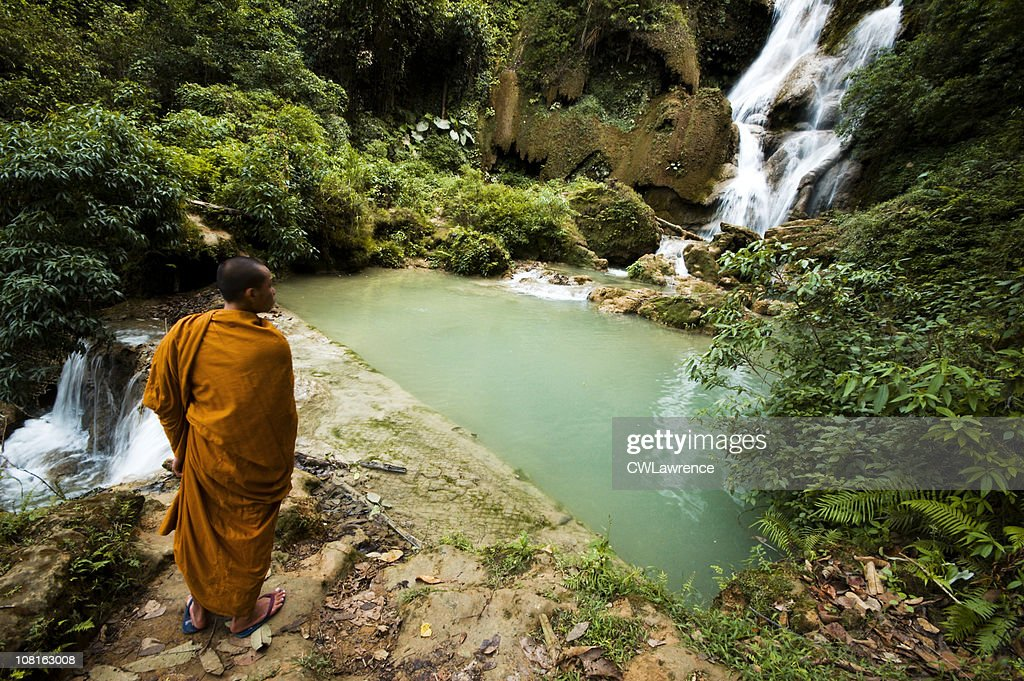 Monk Viewing Tat Kuang Si Waterfall in Laos : Stock Photo