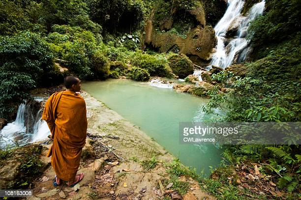 Monk Viewing Tat Kuang Si Waterfall in Laos