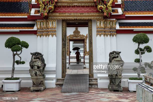 A monk walks through a doorway at a nearempty Wat Pho in Bangkok Thailand on Wednesday Sept 2 2020 Thailand has reported zero locallytransmitted...