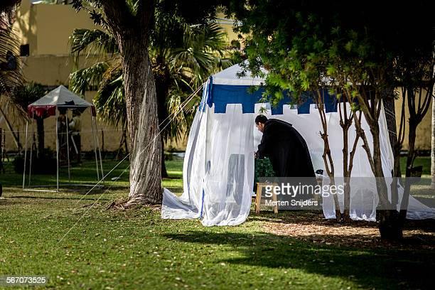 monk wearing robe in festival tent - merten snijders - fotografias e filmes do acervo