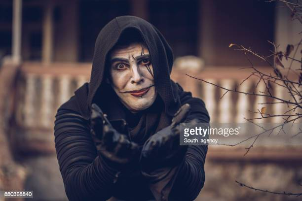 monk with a hood - ugly black men stock photos and pictures